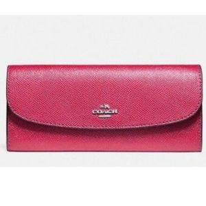 coach // magenta crossgrain leather flap wallet